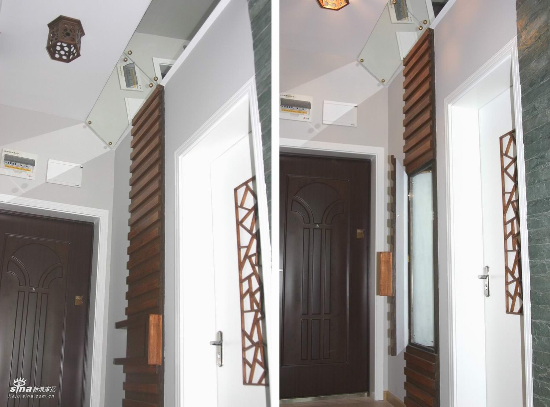 同时过道天花上的灯与之联动而开启.旁边是厨房门.图片