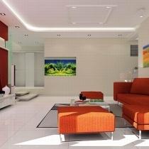 沙发背面的顶上用白色的筒灯代替了繁重的吊顶,左面的墙壁上摆放镶入