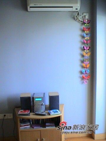 彩蝶栖息的空调机